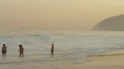 Slow motion pan of surfers and people enjoying Ipanema beach Footage