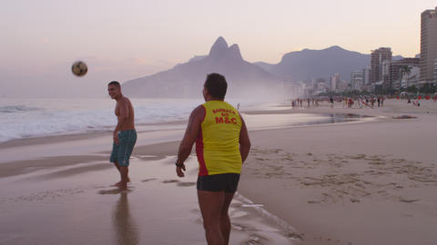 Two men on Ipanema beach playing soccer Footage