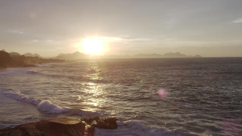 Waves roll onto Ipanema Beach during sunset in Rio de Janeiro Footage