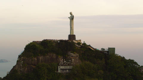 Aerial tracking shot of Christ the Redeemer statue in Rio de Janeiro, Brazil Footage