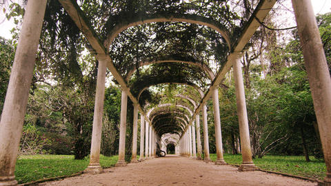 Slow tracking shot directly in the middle of the walkway of the arches in Jardim Footage
