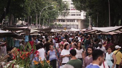 RIO DE JANEIRO, BRAZIL - JUNE 23: Slow motion, people walking at market on June  Live Action