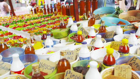 Panning shot of different spices and pepper varieties in a market in Rio de Jane Footage
