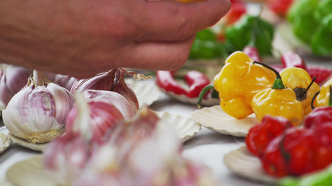 Close-up shot hand choosing bulbs of garlic and different peppers in Rio de Jane Footage