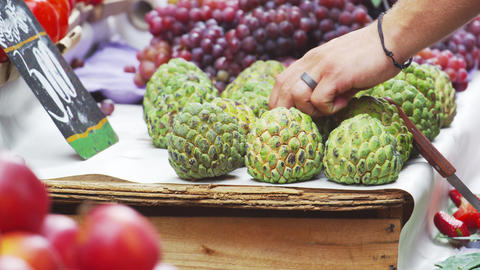 Slow motion shot of sugar apples and other fruits at a market in Rio de Janeiro, Footage