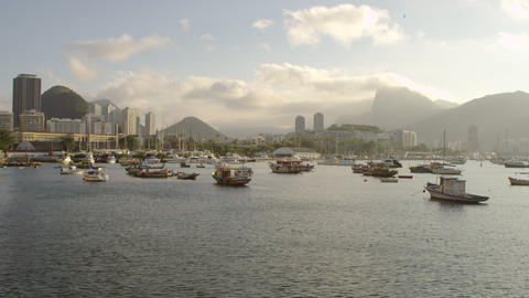 Slow pan of anchored boats in a hazy Rio marina Footage
