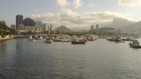 Pan of anchored boats in a hazy Rio marina Footage