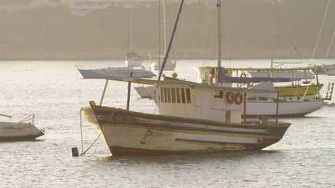 Pan Of Of A Moving Boat In A Rio Harbor stock footage