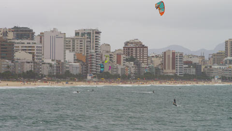 Parasailing surfer is distance from shore and goes under Footage