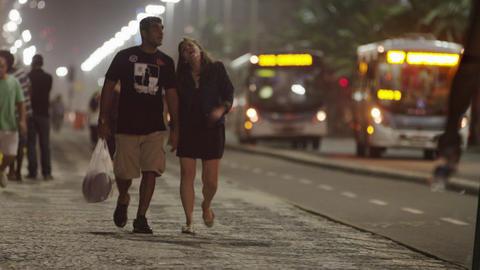 Couple walking and holding hands in Rio Footage