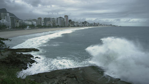 Slow motion shot of big waves crashing onto the rocks at the beach in Rio de Jan Footage