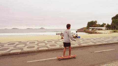 RIO DE JANEIRO, BRAZIL - JUNE 23: Slow dolly shot of skateboard boy at Ipanema J Footage