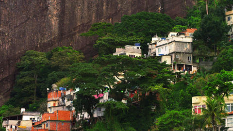 Panning shot of a favela along the mountainside in Rio de Janeiro, Brazil Footage