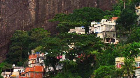 Panning shot of a favela along the mountainside in Rio de Janeiro, Brazil Footage