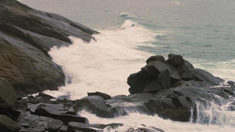 Slow pan of rocky coastline of Rio de Janeiro, Brazil Footage