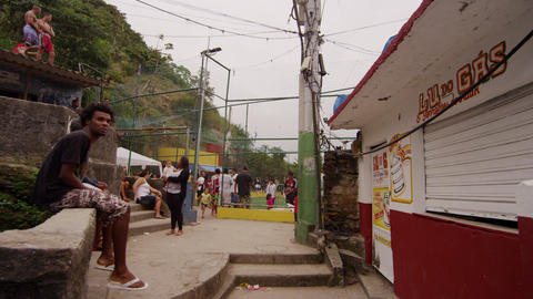 RIO DE JANEIRO, BRAZIL - JUNE 23: Slow dolly shot, favela occupants on June 23,  Live Action