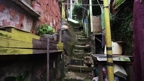 Tracking shot of crowded shanties along the stairs in a favela in Rio de Janeiro Footage