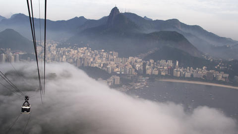 Gondola ride down the mountain on a misty day in Rio de Janeiro, Brazil Footage