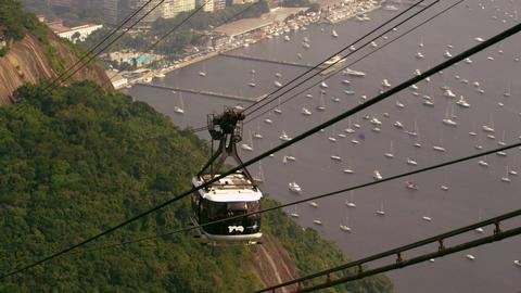 Shot of gondola going up the mountain in Rio de Janeiro, Brazil Live Action