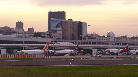 RIO DE JANEIRO, BRAZIL - JUNE 21: Small plane, taxis down runway in front of Rio Footage