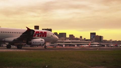 RIO DE JANEIRO, BRAZIL - JUNE 21: Lens flare shot of taxiing plane on Jun 21, 20 Footage