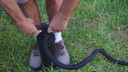 Man Using Air Pump On Grass stock footage