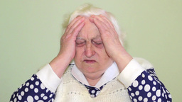 Old woman suffering from headache Footage