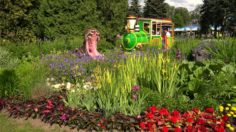 Kids train in an amusement Park. 4K Footage