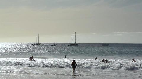 Children Playing In The Sea At Tarrafal stock footage