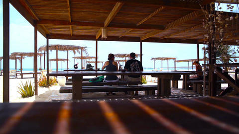 Couple Sits And Eats At A Restaurant On Boa Vista stock footage