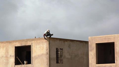 Man Works On A Roof On Boa Vista stock footage