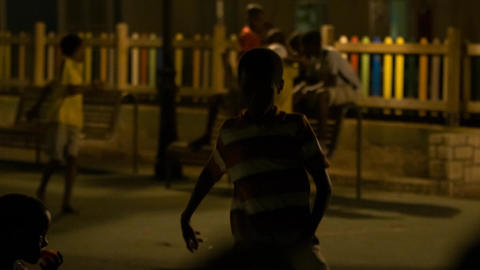 young boy dances on the street in Cape Verde Footage