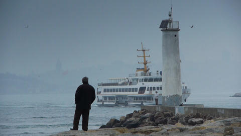 Lonely man by scenic lighhouse Stock Video Footage
