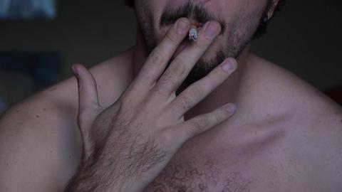 Man smoking cigarette Stock Video Footage