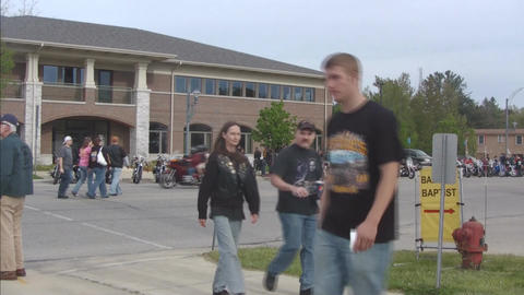 Motorcycle gathering with passersby Stock Video Footage