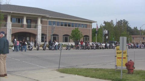 Motorcycle gathering with passersby Footage