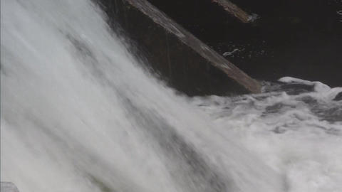 Water flowing over dam closeup Stock Video Footage
