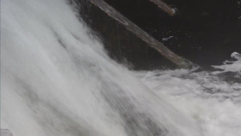 Water flowing over dam closeup Footage