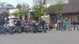 Motorcycle group parked in main street 2 Stock Video Footage