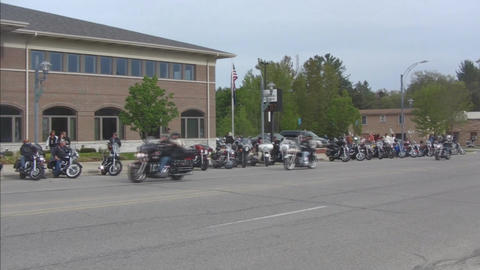 Motorcycle group parked on street pan Stock Video Footage