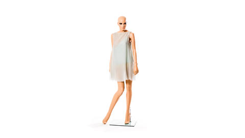 female display-dummy dresses herself in stop-motio Live Action