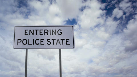 Entering Police State Sign Clouds Timelapse stock footage