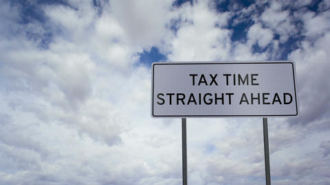 Tax Time Ahead Sign Clouds Timelapse Footage