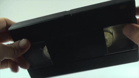 Checking The Tape On An Old VHS Tape, Isolated On  stock footage