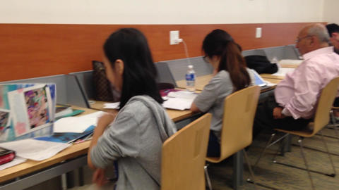 People Studying At Library stock footage