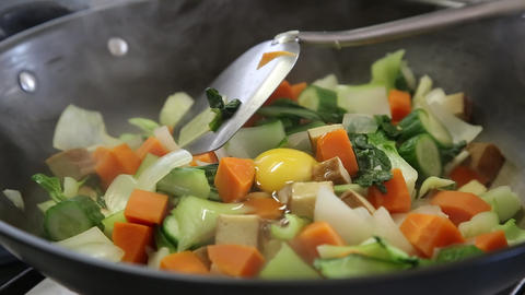 Woman Cooking Vegetables stock footage