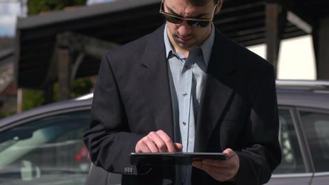 Businessman working on digital tablet ライブ動画