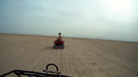 Driving Quadbike Trough The Desert stock footage