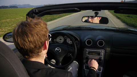 Young businessman driving convertible Footage