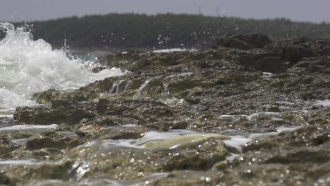 SLOW MOTION: Waves splashing on the rocky coast Footage